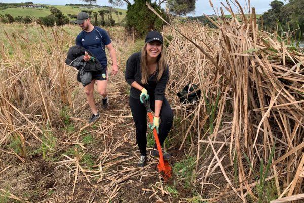 Volunteer Megan Price Planting at Marie Neverman Reserve charities - Volunteer Megan Price Planting at Marie Neverman Reserve 600x400 - Our Giving Back Program